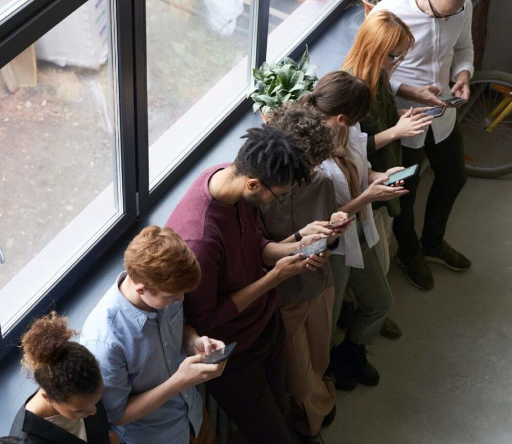 group of people viewing their smartphones